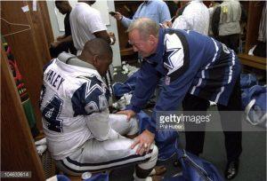 Jerry Jones addresses player in locker room