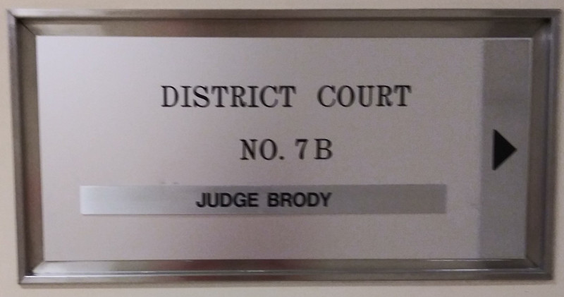 sign pointing to Judge Brody's courtroom