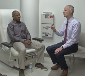 White consulting with his doctor shortly after his ALS diagnosis